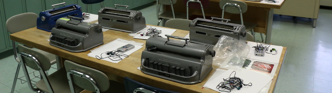 Image of BrailleWriters and BookPorts on a classroom desk